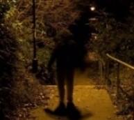 man-in-dark-alley